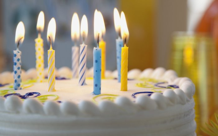 Nine birthday candles in the cake