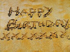Happy birthday on the sand